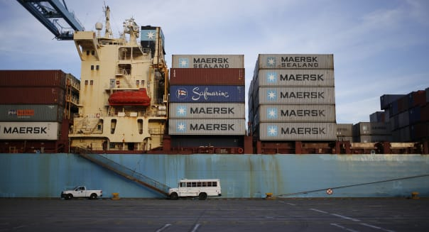 Container Ships Are Unloaded At An APM Terminal In Virginia