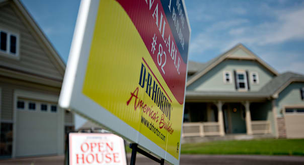 A 'Open House' sign stands outside a new home for sale in the D.R. Horton Inc. Cambridge at Southbury development in Oswego, Illinois, U.S., on Tuesday, Aug. 20, 2013. The Commerce Department is scheduled to release new home sales figures on Aug. 23. Photographer: Daniel Acker/Bloomberg via Getty Images