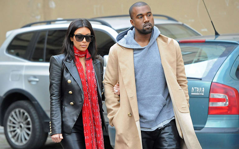 Kim and Kanye looking bored