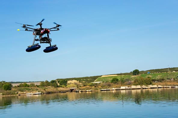 Drone or Unmanned Aerial Vehicle (UAV) used for photography / filming flying by canal de Caronte, Martigues, France