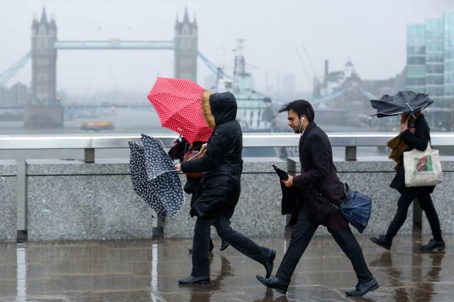 Commuters Battle The Storm Doris Weather Front