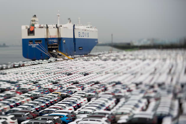 Hyundai Motor Co. vehicles bound for export are driven into a Hyundai Glovis Co. roll-on/roll-off (RORO)...