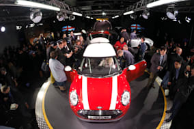 File photo dated 18/11/13 of the new BMW Mini being unveiled at their plant in Oxford. The new Mini is to be built in Holland as well as the UK, owner BMW has announced. PRESS ASSOCIATION Photo. Issue date: Monday February 17, 2014. The German motor giant said production of the Mini Hatch will be split between its factory in Oxford and a site in Nedcar in Born. Around 1,500 workers will build the new Mini in Holland from this summer at a factory run by BMW's Dutch partner VDL Nedcar. See PA story INDUSTRY Mini. Photo credit should read: Steve Parsons/PA Wire