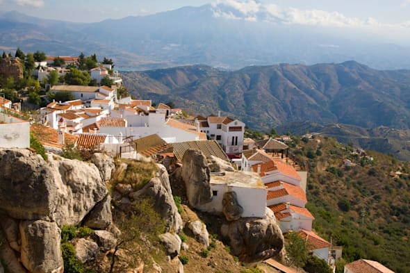 View of the mountain top Moorish village of Comares, Malaga province, Spain