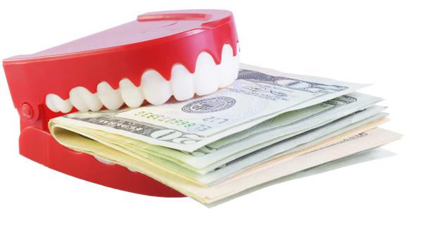 joke teeth eating a wad of us...