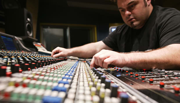 Sound engineer in recording studio    * Club    * Single    * Venue    * People    * Activity    * Event    * Equipment