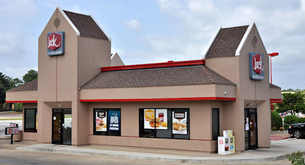 A Jack In The Box Restaurant in Tyler Texas sits along Broadway open for business.