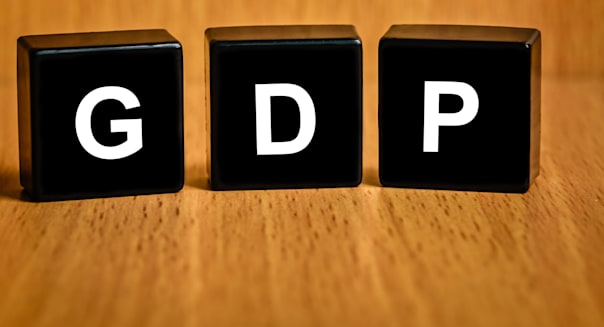 gross domestic product or GDP text on black block