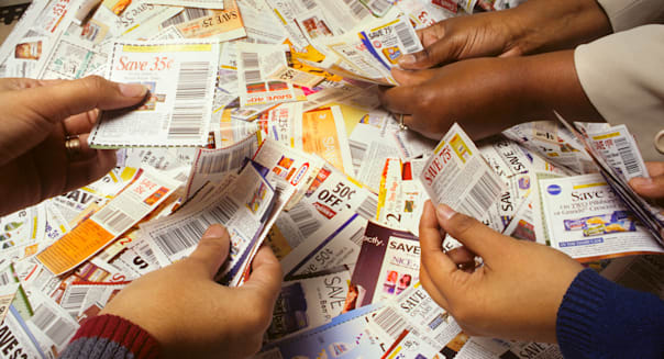AWYYXX Multi ethnic womens hands sort cents off promotional coupons. Image shot 2002. Exact date unknown.Photographer :   Ted
