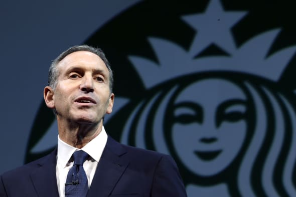 Starbucks Budget Battle (FILE - In this March 20, 2013 file photo, Starbucks CEO Howard Schultz speaks at the company's annual s