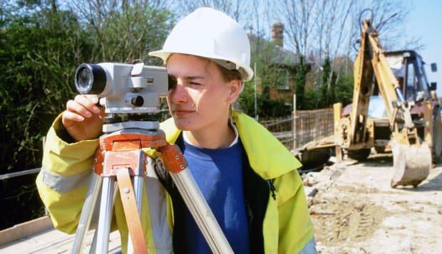 Female civil engineer working on building site, UK