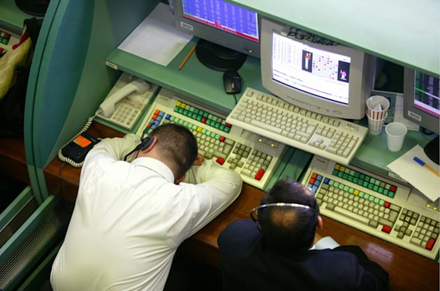 Electronic trade at the Istanbul Stock Exchange, ISE: broker sleeping at his desk.