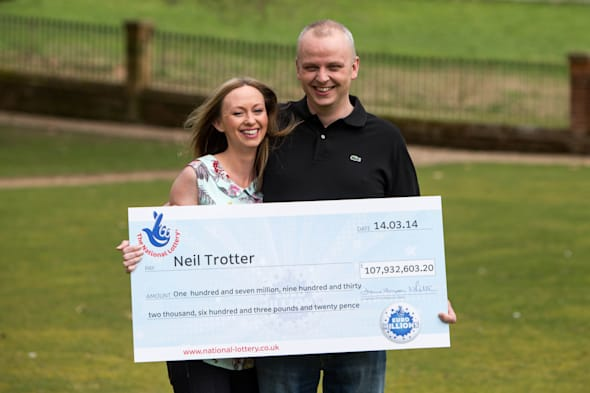 Car mechanic and racing driver Neil Trotter, with partner Nicky Ottaway,  celebrates his win in Dorking, Surrey where he was revealed as the man who scooped a £107.9 million jackpot on the Euromillions lottery. PRESS ASSOCIATION Photo. Picture date: Tuesday March 18, 2014. Hot rod racer Trotter, 41, who runs a repair garage in Mitcham, south London called Chameleon Coachworks, became the National Lottery's fourth biggest winner on Friday night. See PA story LOTTERY Winner. Photo credit should read: Steve Parsons/PA Wire