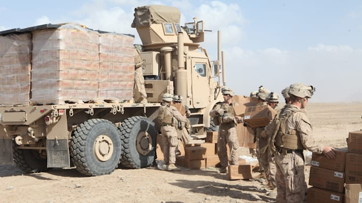 Soldiers unloading MREs and water
