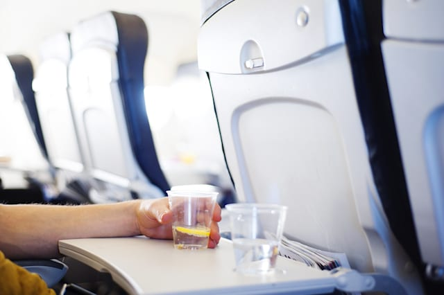 Why you actually shouldn't drink water on a plane