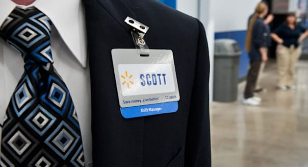 Anglo male shift manager at Walmart is ready to greet customers at grand opening of new store in Austin, Texas, USA.