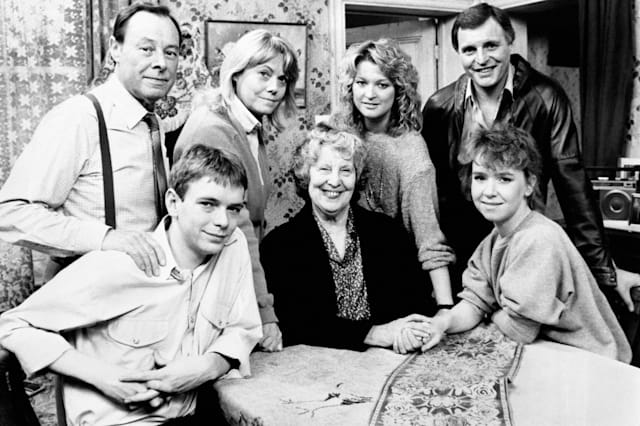 """A 'Family Album' gathering to mark the passing of Lou Beale, matriarch of Albert Square and Britain's favourite television granny, who """"has died peacefully in her sleep"""" so that actress Anna Wing couldwithdraw from the cast of the BBC-1 top-rated serial to work on other projects.Lou is seated with Ian (Adam Woodyatt) and Michelle (Susan Tully).Standing are, from left: Arthur (played by Bill Treacher); Pauline (played by Wendy Richard), Kathy (played by Gillian Taylforth) and Pete (played by Peter Dean)"""