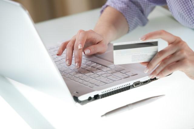 woman's hand entering data...