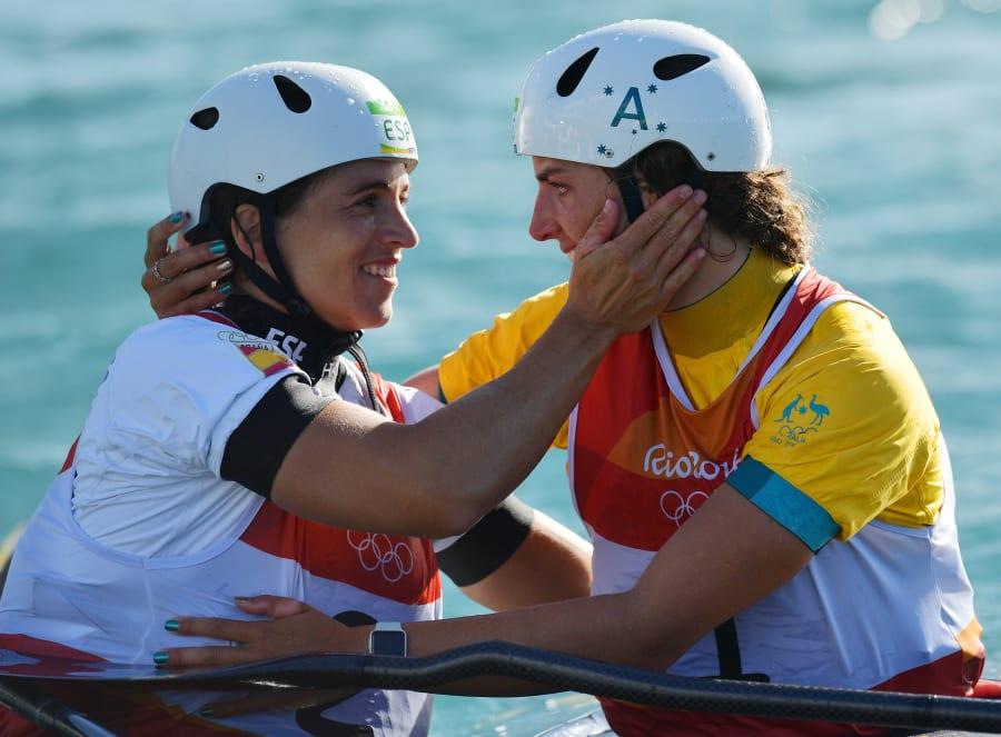 Maialen Chourraut and Jess Fox share a hug. So