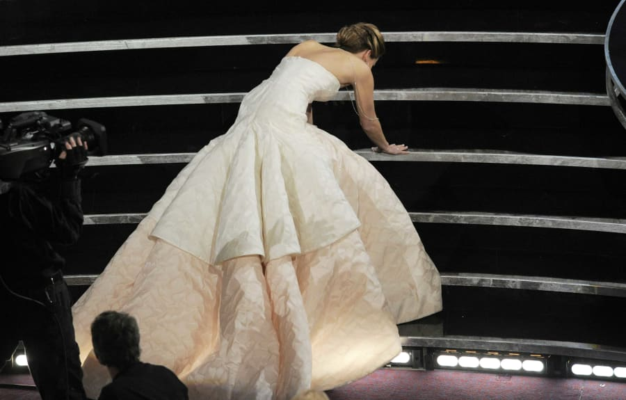 Even Oscar winners stack it in heels. Here's Jennifer Lawrence after falling over on her way to accept...