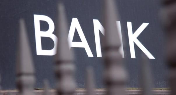 Bank sign behind iron railings at Bank tubes station, London.