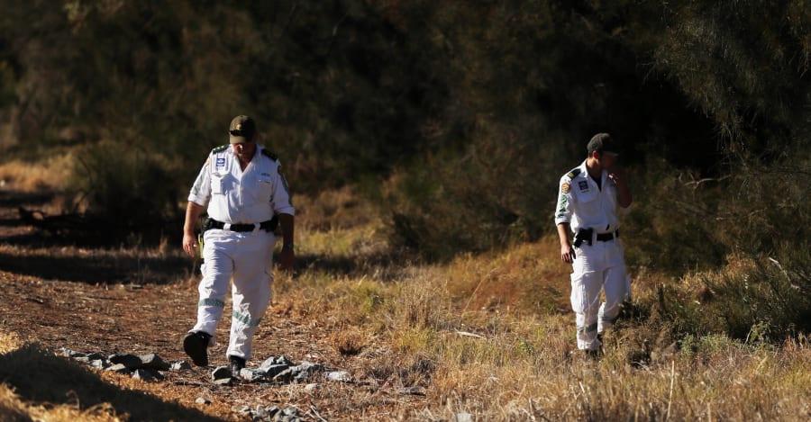 Leeton Volunteer Rescue members search for the body of murdered school teacher Stephanie
