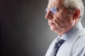 C44C46 Photo of senior employer on black background business; people; businesspeople; man; male; businessman; person; senior; ma