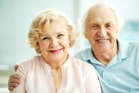 portrait of smiling seniors...