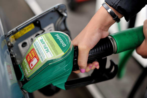 File photo dated 15/08/13 of a person using a petrol pump as petrol prices are at a three-year low, according to figures from the AA. PRESS ASSOCIATION Photo. Issue date: Friday March 21, 2014. But the good news for drivers is offset by a real-terms dip in earnings which has pushed wages back to 2002 levels adjusting for inflation, the AA added. Petrol forecourt prices averaged 129.46p a litre in mid March compared to 129.63p in mid February. A year ago petrol averaged 138.42p a litre. See PA story TRANSPORT Petrol. Photo credit should read: Nick Ansell/PA Wire