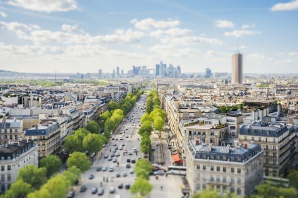 Avenue de la Grande Armee in Paris with tilt shift effect. La Defense seen from the Arc de Triomphe.
