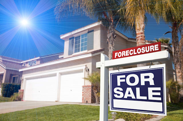 BNNGWT Blue Foreclosure For Sale Real Estate Sign in Front of House with Blue Star-burst in Sky.  real; estate; foreclosure; sig