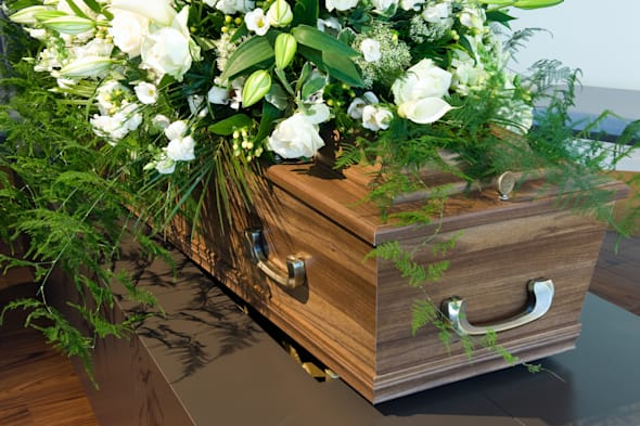 a coffin in a morgue with a...