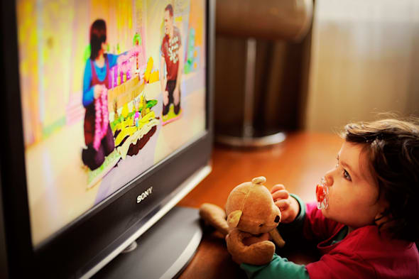 Toddler / Child watching TV with teddy bear and dummy