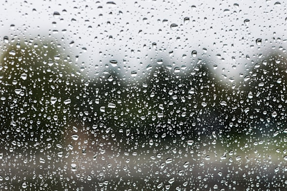 rain drops on glass with a...