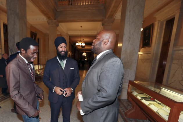 Journalist Demond Cole, left, then-deputy Ontario NDP leader Jagmeet Singh, centre, and African Canadian...