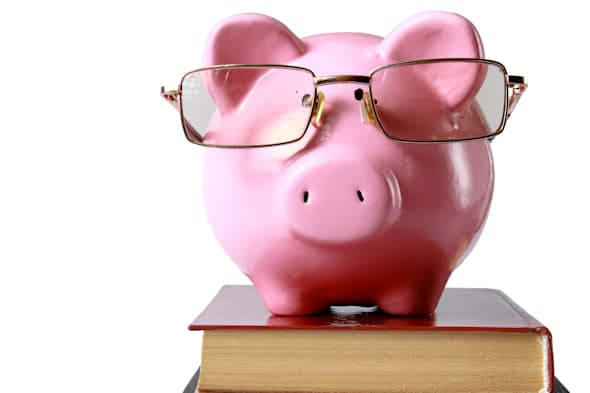piggy bank with glasses and...