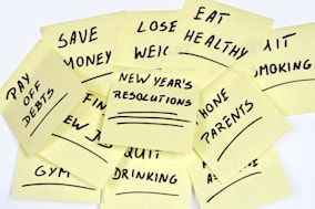lots of New Year's Resolutions on yellow pieces of paper