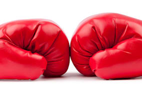 red boxing gloves isolated on...