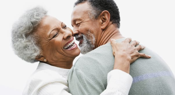Happy retired couple embracing