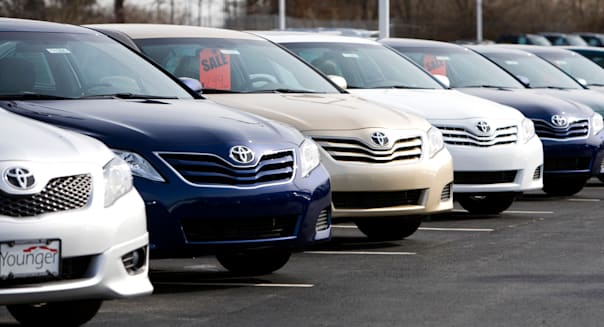 Toyota vehicles on a dealership lot.