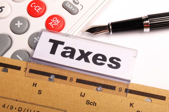 tax or taxes concept with word on business folder index