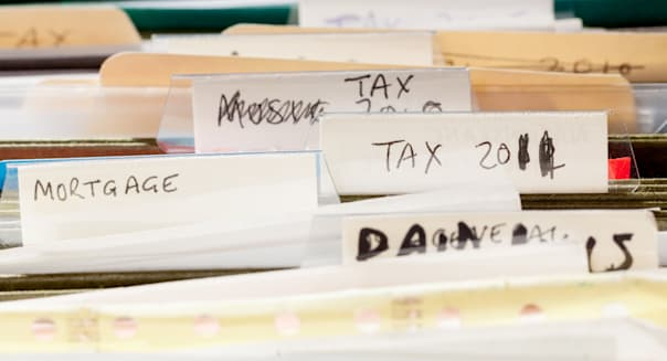 CMPH1B Folders in file drawer sorted into tax years and mortgage documents  folders; file; drawer; tax; papers; documents; filin