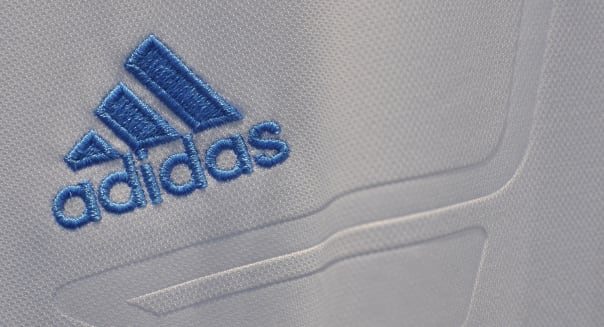 Adidas shares jump on report of bid for Reebok unit