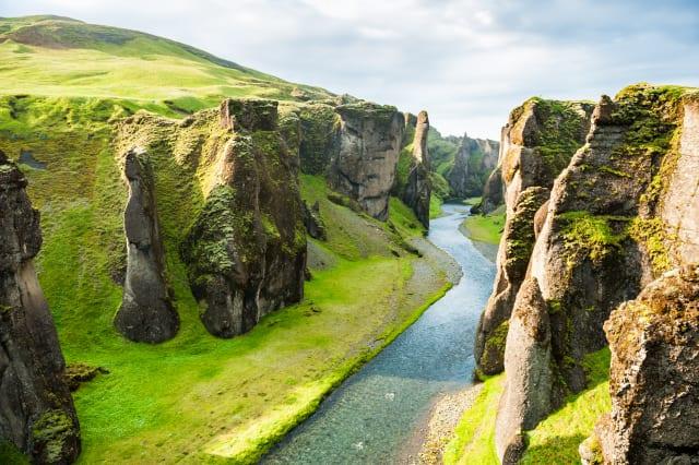 Fjadrargljufur canyon with river and big rocks.