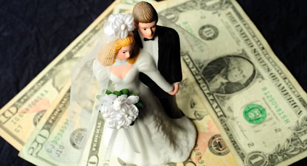 bridal couple with money