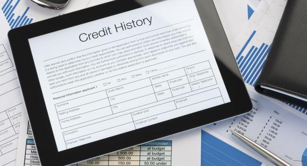 Online credit history form on a digital tablet