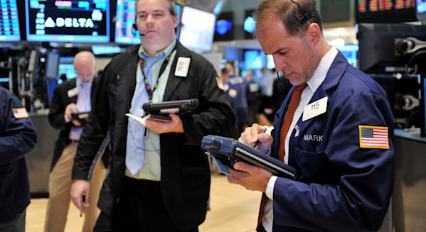 new york stock exchange traders wall street stocks investing earnings economic news