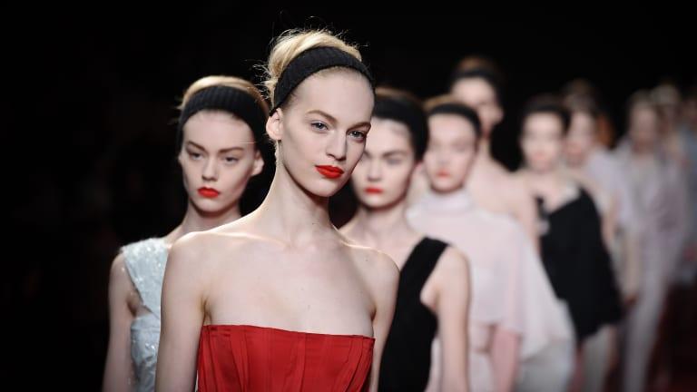 Topless protesters crash Nina Ricci's runway show