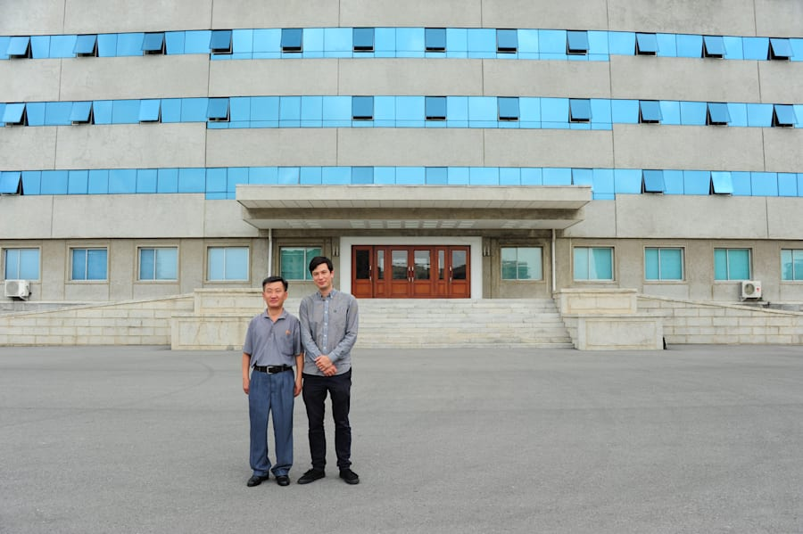 Alek and Mr Ri outside the building they took classes