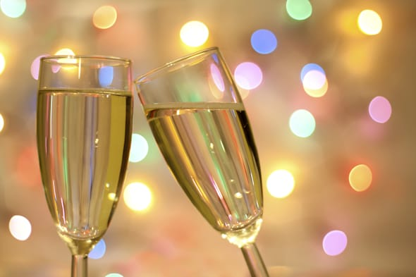Two glasses of champagne on blurred new year party background